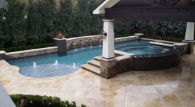 Custom Geometric Pool with Tanning Ledge and Fire Bowls