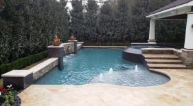 Custom Pool with Fire Features, Tanning Ledge and Scuppers