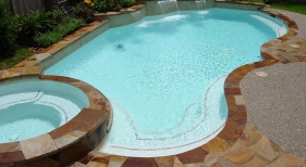 Freeform Pool and Spa with Raised Sheer Descents