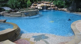 Freeform Pool with Custom Tanning Ledge, Island, and Waterfall