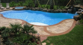 Freeform Pool with Tanning Ledge and Raised Rock Wall