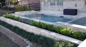 Geometric Pool With Raised Spa and Sheer Descents
