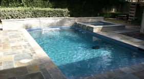 Geometric Pool with Raised Spa and Wall
