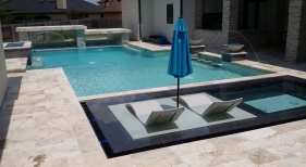 Geometric Pool with Raised Tanning Ledge and Spa