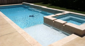 Geometric Pool with Tanning Ledge and Raised Wall